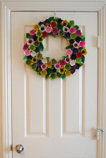 egg carton wreath on white door