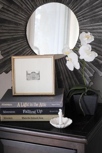 grey starburst mirror orchid nightstand styling