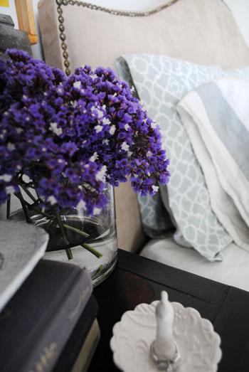 nightstand fresh purple flowers ring holder