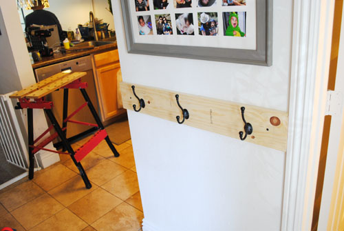 unfinished wood rack mounted to wall