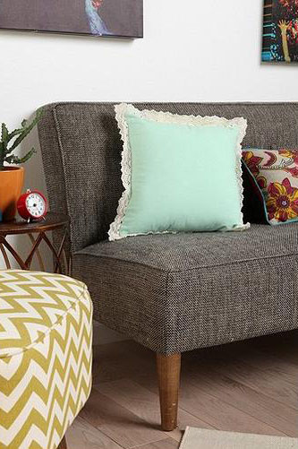 grey sofa with mint pillow