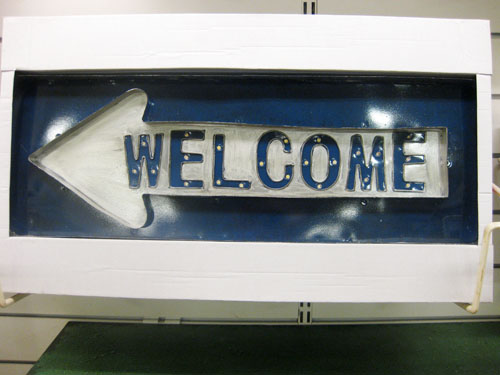 blue metal welcome sign
